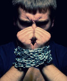 Chained man. Angry man with chained hands Stock Images