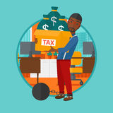 Chained man with bags full of taxes. Royalty Free Stock Photography
