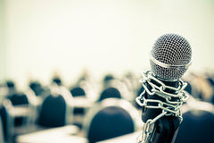 A chained microphone Stock Photo