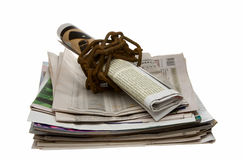 Chained newspapers - freedom of speech concept. Newspaper wrapped by rusty chain Stock Images