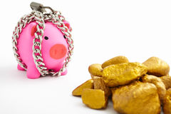 Chained piggy bank and gold Stock Photo