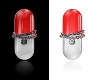 Chained pill Stock Photo