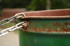 Chained Rusty Garbage Can Royalty Free Stock Photos
