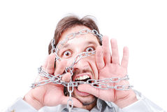 Chained screaming man. A man with chains on his face and hands screaming Royalty Free Stock Photo