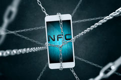 Chained smartphone with NFC symbol. Royalty Free Stock Photos