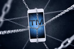 Chained smartphone with trademark symbol. Chained smartphone with `trademark` symbol. Conception of intellectual property stock image