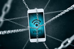 Chained smartphone with Wifi symbol. Stock Photography