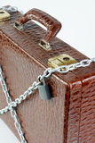 Chained suitcase with a padlock Stock Photography