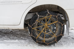 Chained tire snow road Stock Image