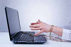 Chained to the computer. Male chained to the laptop. Workaholic. Concept Royalty Free Stock Images