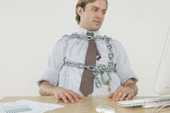 Chained to the desk Royalty Free Stock Image