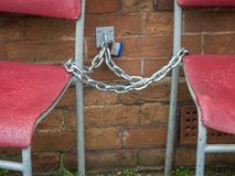 Chained-up chairs, Bexhill-On-Sea, East Sussex, UK royalty free stock images