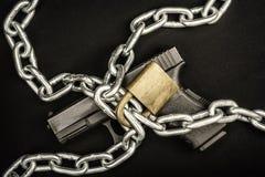 Chained up handgun Royalty Free Stock Photo