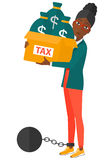 Chained woman with bags full of taxes Stock Photo