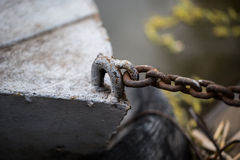 Chained wooden boat is waiting for sunday passengers Royalty Free Stock Image