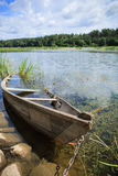 Chained wooden rowing boat Royalty Free Stock Photo