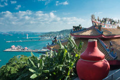 Chainese temple. Chinese temple roof with blue sky and sea in the island Stock Image