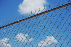 Chainlink fence. Against blue sky Royalty Free Stock Photo