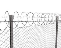 Chainlink fence with barbed wire on top Stock Photos