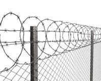 Chainlink fence with barbed wire on top closeup Royalty Free Stock Images