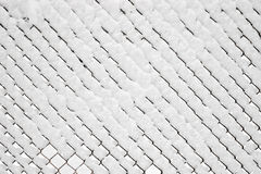Chainlink under snow Royalty Free Stock Photography