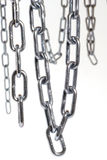 Chains. Hanging in front of white background Stock Photo