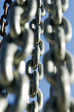 Chains. Group of chains against a blue sky Stock Photos