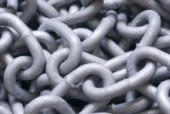 Chains. A tangled backdrop of metal chain links Royalty Free Stock Photography