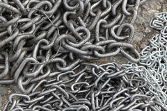 Chains. Big pile of strong steel chains stock images