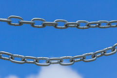 Chains on a blue sky background Royalty Free Stock Image