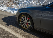 Chains on car weels in snowy mountains during winter Stock Images