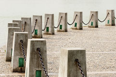 Chains and cement posts Stock Photo