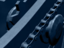 Chains and gears in blues Stock Image