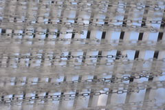 Chains. Hanging rows of iron chains Royalty Free Stock Photography
