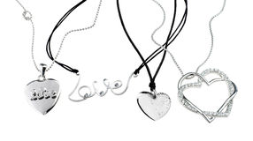 Of chains with heart pendants isolated on white Royalty Free Stock Photo