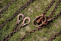 Chains and hooks for towing. Old chains and hooks on the grass Stock Photography