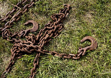 Chains and hooks for towing. Old chains and hitch on the grass Royalty Free Stock Photos