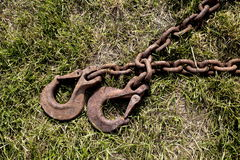 Chains and hooks for towing. Old chains and hitch on the grass Stock Photography