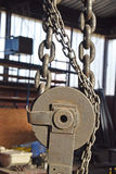 The chains, pulleys. The details of the structure for lifting with chains, pulleys Royalty Free Stock Photography