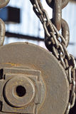 The chains, pulleys. The details of the structure for lifting with chains, pulleys Stock Photo