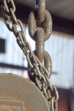 The chains, pulleys. The details of the structure for lifting with chains, pulleys Royalty Free Stock Image