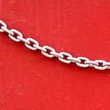 Chains on red wall background Royalty Free Stock Photography
