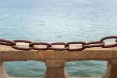 Chains and stone as background texture Stock Image