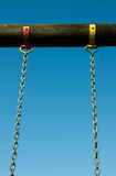 Chains Swing attached do a Wood Log Royalty Free Stock Image