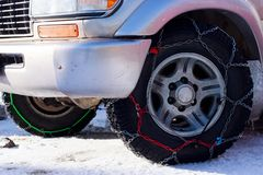 The chains on a wheel. The chains snow for a wheel car royalty free stock photo