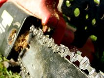 Chainsaw. Detail photo of the chainsaw background stock photography