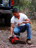 Chainsaw. Image of male with chainsaw Royalty Free Stock Photos