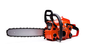 Chainsaw. New red chainsaw isolated on white stock images