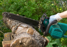 Chainsaw. And log of birch royalty free stock photo