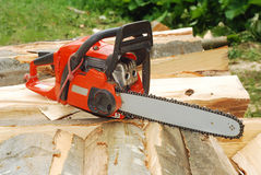Chainsaw. Over a heap of logs stock photo